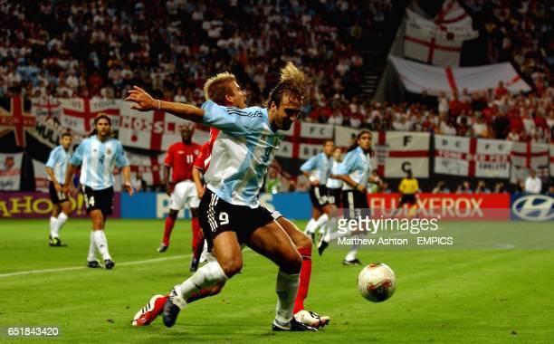 England's David Beckham fouls Gabriel Batistuta of Argentina