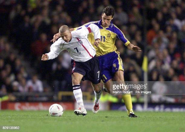 England's David Beckham in action against Sweden's Zlatan Ibrahimovic during the England and Sweden Nationwide International match at Old Trafford...