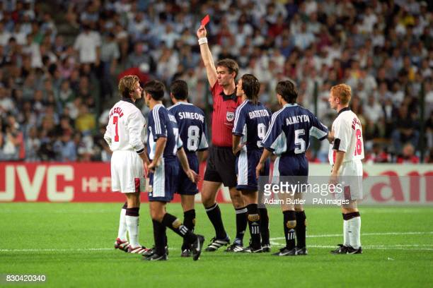 England's David Beckham is given the red card by Danish referee Kim Milton Nielsen after a foul on Argentina's Diego Simeone during their France '98...