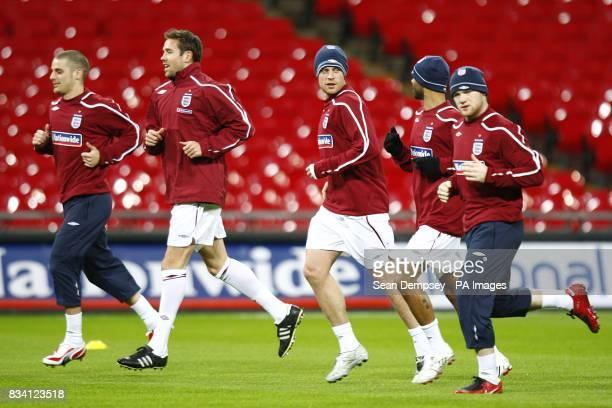 England's David Bentley Matthew Upson Wayne Bridge Ashley Cole and Wayne Rooney are put through their paces in training