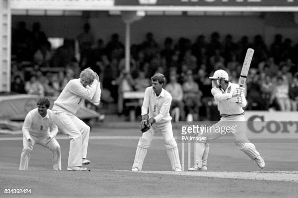 England's David Gower shelters from a MartynCrowe drive from a Phil Edmonds delivery in NZ first innings of the second Cornhill insurance Test Crowe...
