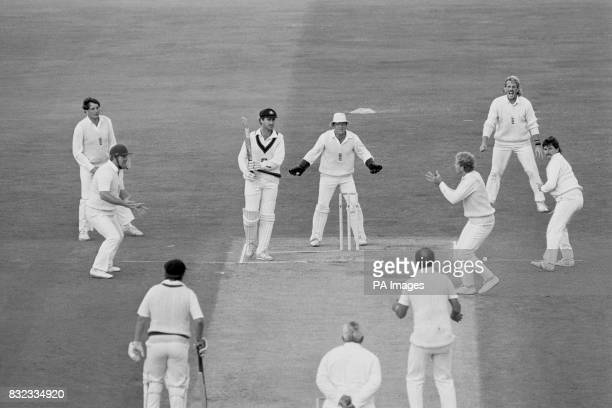 England's David Gower takes a catch to dismiss Australia's Wayne Phillips after the ball had deflected off the boot of Allan Lamb into his hands...