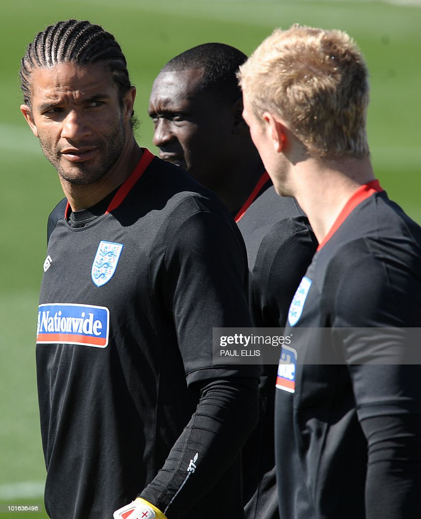 England's David James (L), Emile Heskey (C) and Joe Hart arrive to take part in a training session at the Royal Bafokeng Sports Campus near Rustenburg on June 5, 2010.
