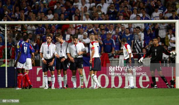 England's David James organises his defensive wall prior to France's Zinedine Zidane scoring the equalising goal