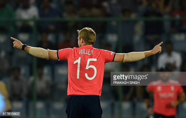 England's David Willey celebrates after his dismissal of Sri Lanka's Tillakaratne Dilshan during the World T20 cricket tournament match between...