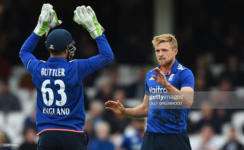 England's David Willey (R) celebrates with England's Jos Buttler after bowling Sri Lanka's Dinesh Chandimal (not pictured) during play in the fourth One Day International (ODI) cricket match between England and Sri Lanka at The Oval cricket ground in London on June 29, 2016. England captain Eoin Morgan elected to field after winning the toss in the fourth one-day international against Sri Lanka at The Oval on Wednesday. ECB
