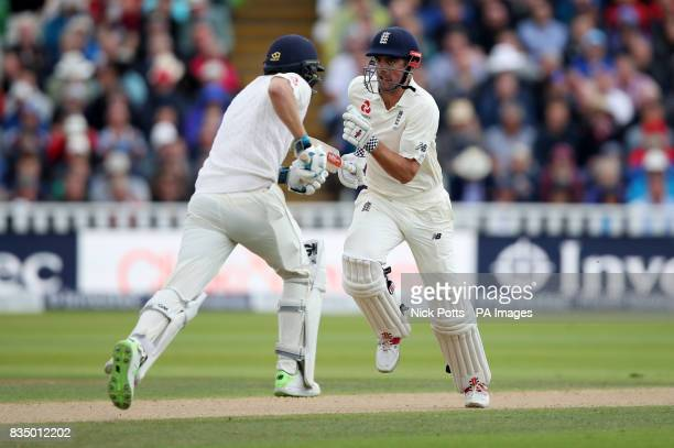 England's Dawid Malan and Alastair Cook make runs during day two of the First Investec Test match at Edgbaston Birmingham
