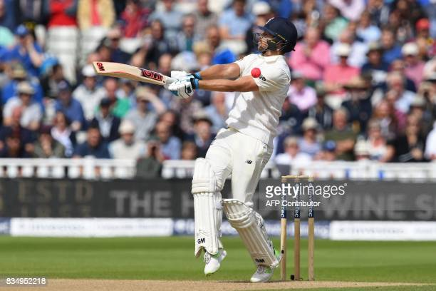 England's Dawid Malan cannot connect with this short ball from West Indies' Kemar Roach during play on day 2 of the first Test cricket match between...