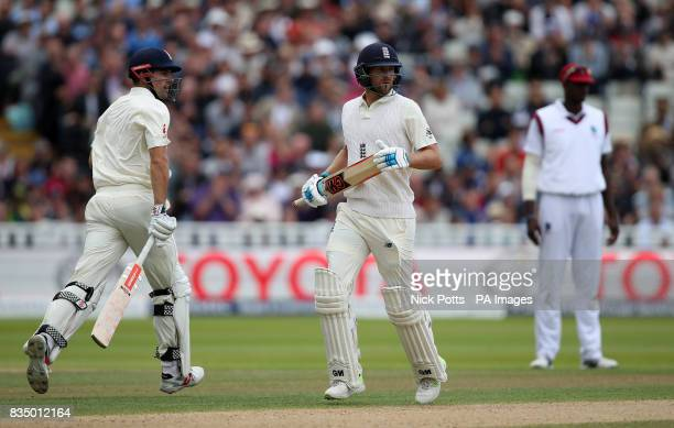 England's Dawid Malan makes his 50 as he runs by Alastair Cook during day two of the First Investec Test match at Edgbaston Birmingham