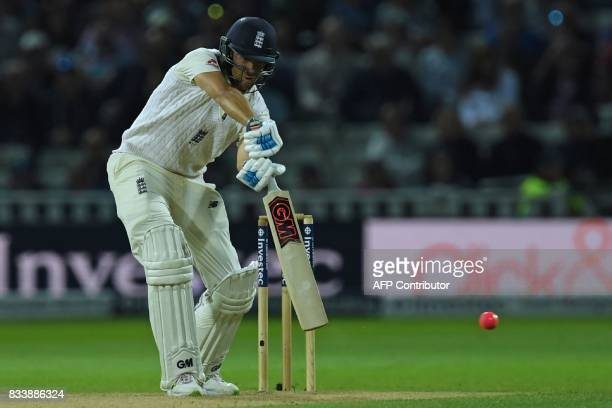 England's Dawid Malan plays a shot during play on the first day of the first Test cricket match between England and the West Indies at Edgbaston in...