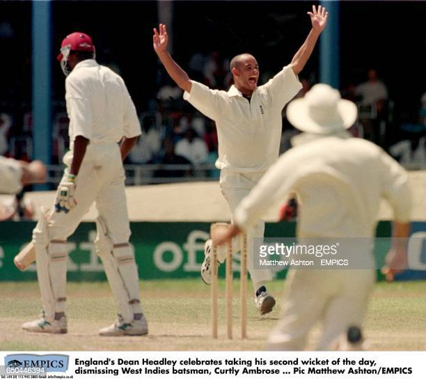 England's Dean Headley celebrates taking his second wicket of the day dismissing West Indies batsman Curtly Ambrose
