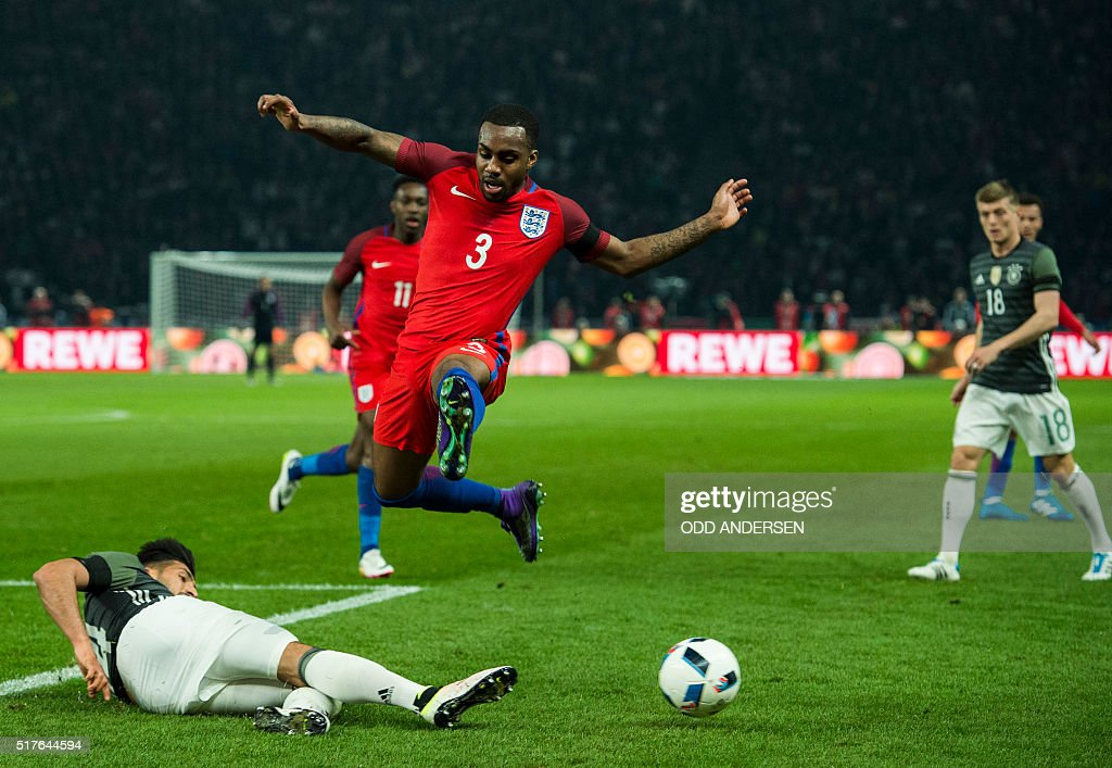 Englands defender Danny Rose and Germany's forward Emre Can vie for the ball during the friendly football match Germany v England at the Olympic...
