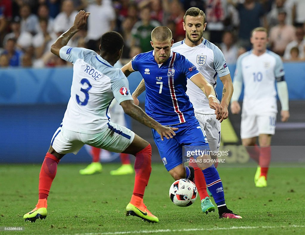 England's defender Danny Rose vies for the ball against Iceland's forward Johann Berg Gudmundsson during Euro 2016 round of 16 football match between England and Iceland at the Allianz Riviera stadium in Nice on June 27, 2016. / AFP / TOBIAS