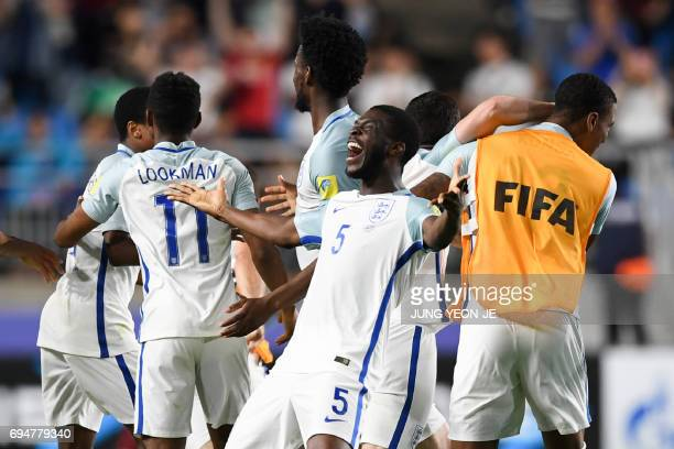 England's defender Fikayo Tomori celebrates their victory during the U20 World Cup final football match between England and Venezuela in Suwon on...
