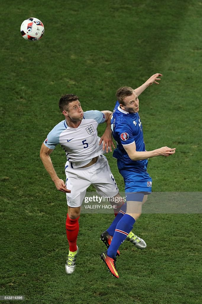 England's defender Gary Cahill (L) and Iceland's forward Jon Dadi Bodvarsson vie for the ball during the Euro 2016 round of 16 football match between England and Iceland at the Allianz Riviera stadium in Nice on June 27, 2016. / AFP / Valery HACHE