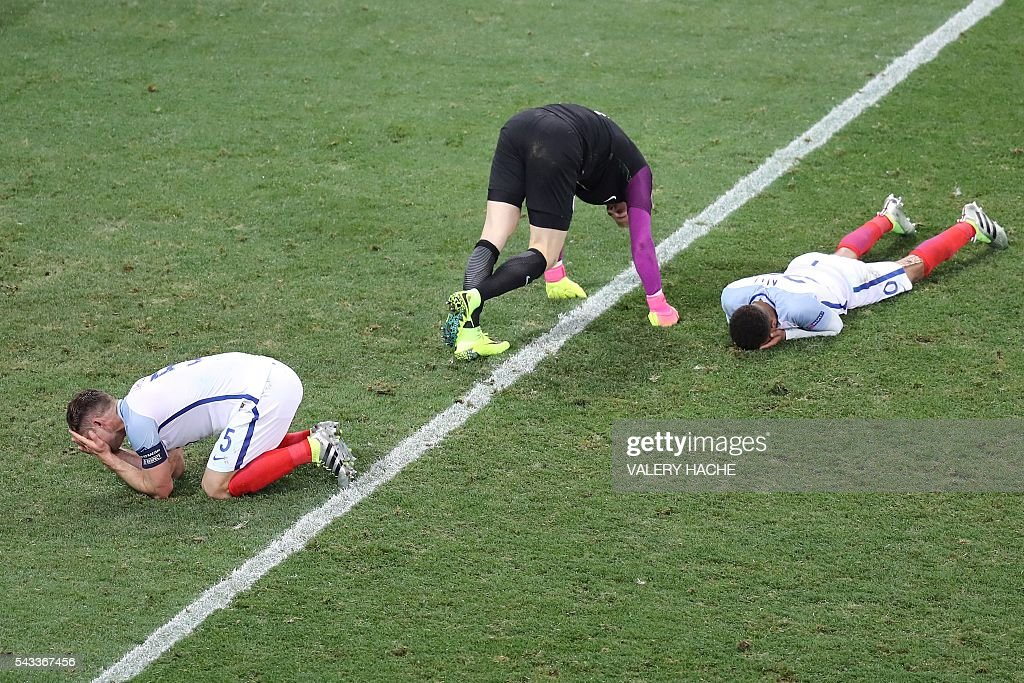 England's defender Gary Cahill, England's goalkeeper Joe Hart and England's midfielder Dele Alli react after the Euro 2016 round of 16 football match between England and Iceland at the Allianz Riviera stadium in Nice on June 27, 2016. Iceland won the match 1-2. / AFP / Valery HACHE