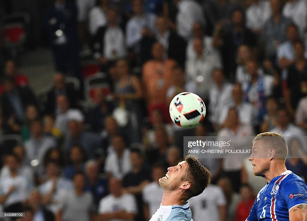 England's defender Gary Cahill (L) Iceland's defender Ragnar Sigurdsson vie for the ball during the Euro 2016 round of 16 football match between England and Iceland at the Allianz Riviera stadium in Nice on June 27, 2016. / AFP / ANNE