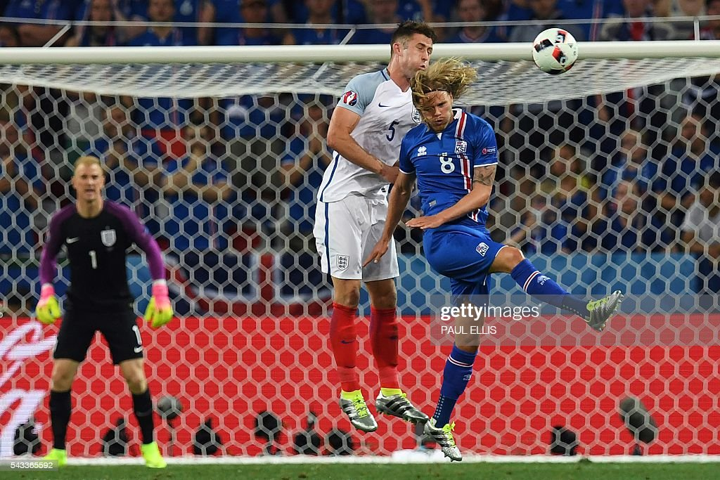 England's defender Gary Cahill (L) jumps for the ball against Iceland's midfielder Birkir Bjarnason during Euro 2016 round of 16 football match between England and Iceland at the Allianz Riviera stadium in Nice on June 27, 2016. / AFP / PAUL