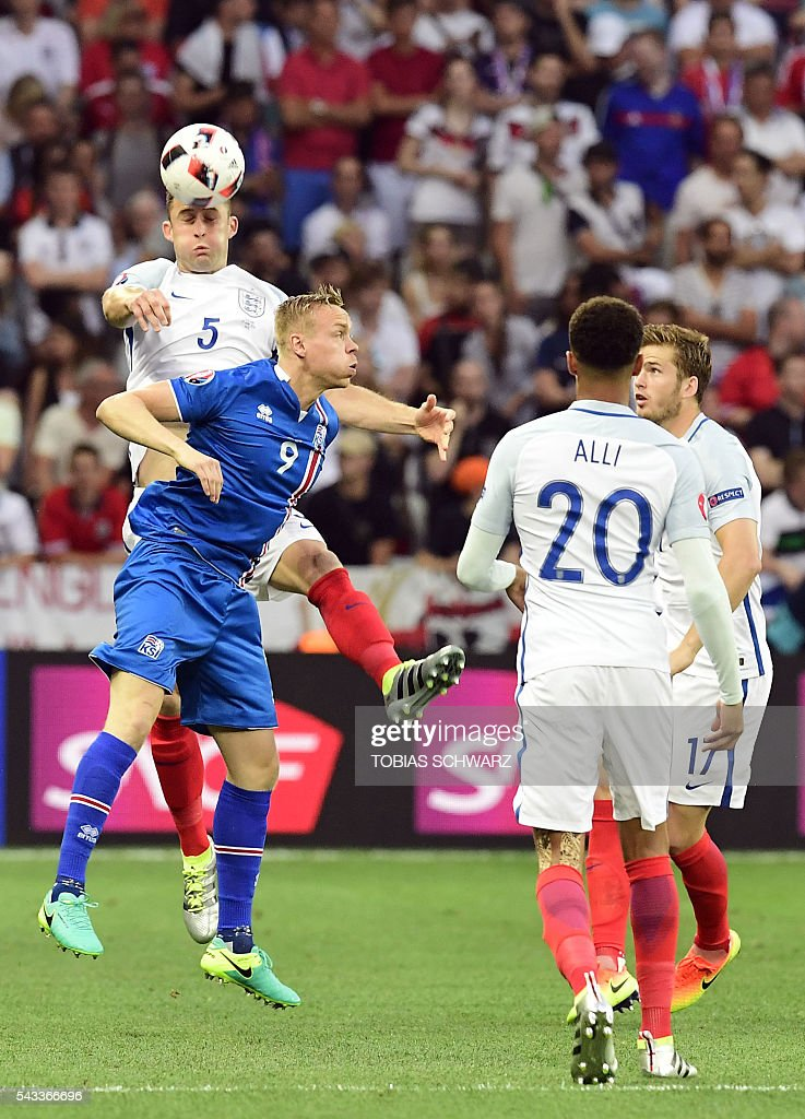 England's defender Gary Cahill (top-L) jumps for the ball against Iceland's forward Kolbeinn Sigthorsson during Euro 2016 round of 16 football match between England and Iceland at the Allianz Riviera stadium in Nice on June 27, 2016. / AFP / TOBIAS