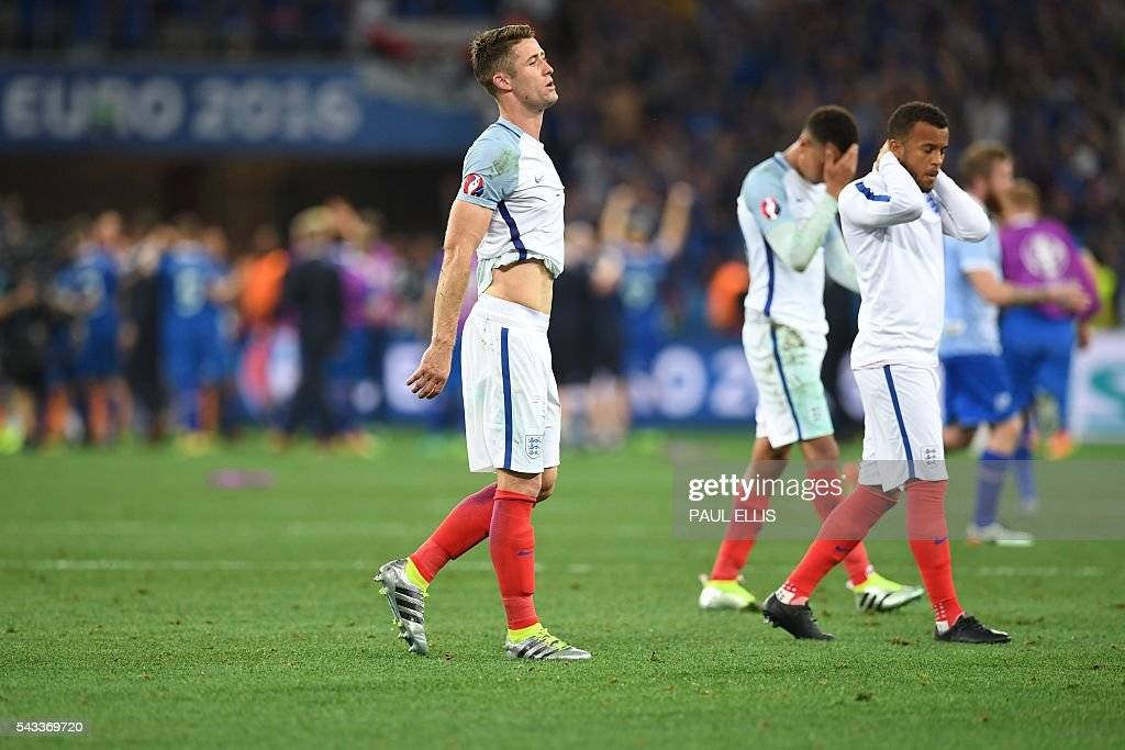 England's defender Gary Cahill (L) reacts after England lost 2-1 to Iceland in the Euro 2016 round of 16 football match between England and Iceland at the Allianz Riviera stadium in Nice on June 27, 2016. / AFP / PAUL