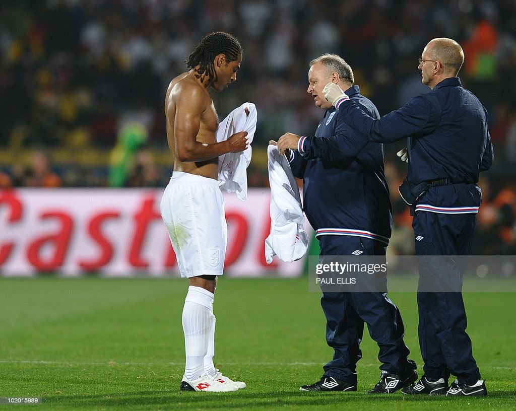 England's defender Glen Johnson changes his jersey during the Group C first round 2010 World Cup football match England vs USA on June 12 2010 at...