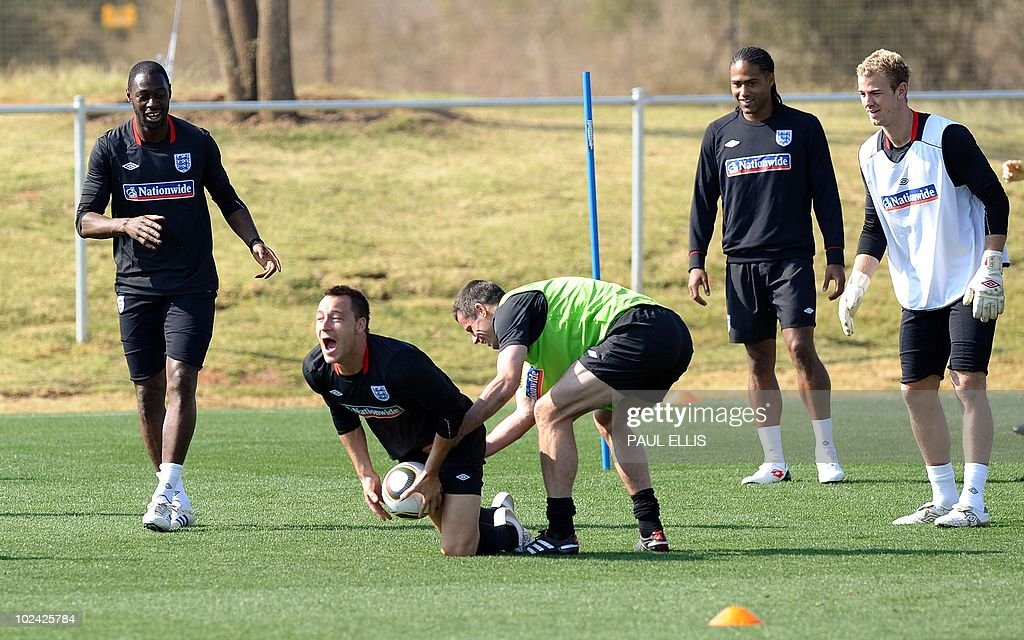 England's defender John Terry takes the ball during a training session at the Royal Bafokeng Sports Campus near Rustenburg on 26 June ahead of their...