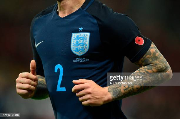 England's defender Kieran Trippier wears an armband with a Remembrance Day poppy on it during the friendly international football match between...