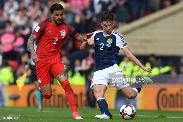 England's defender Kyle Walker vies with Scotland's defender Kieran Tierney during the group F World Cup qualifying football match between Scotland...