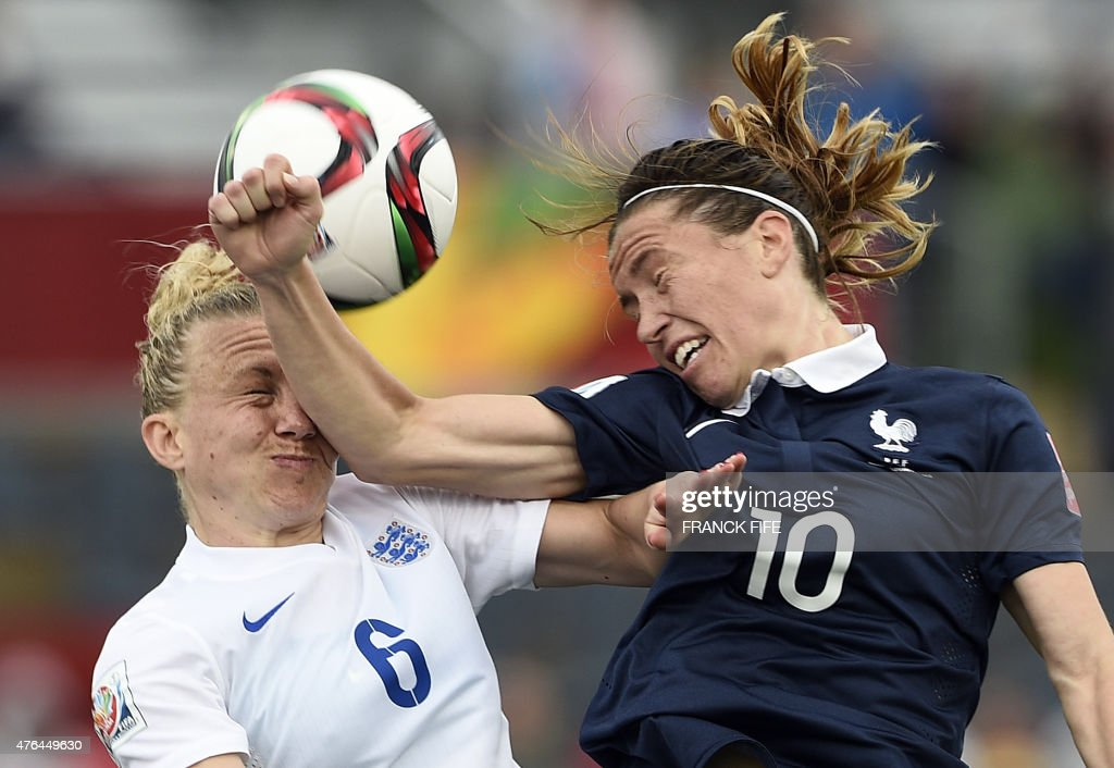 England's defender Laura Bassett (L) vies with France's midfielder Camille Abily during a Group F match at the 2015 FIFA Women's World Cup between France and England at Moncton Stadium in Moncton, New Brunswick on June 9, 2015.