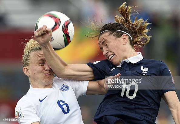 England's defender Laura Bassett vies with France's midfielder Camille Abily during a Group F match at the 2015 FIFA Women's World Cup between France...