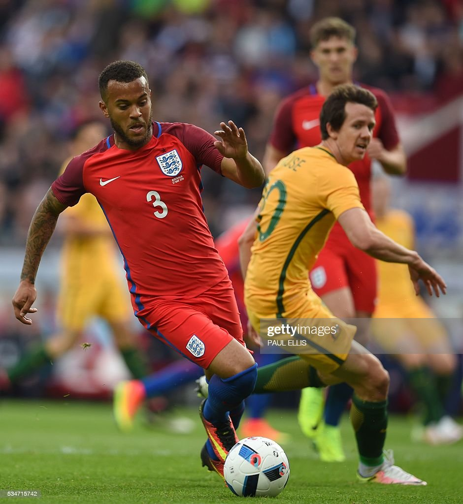 England's defender Ryan Bertrand (L) in action during the friendly football match between England and Australia at the Stadium of Light in Sunderland, north east England, on May 27, 2016. / AFP / PAUL