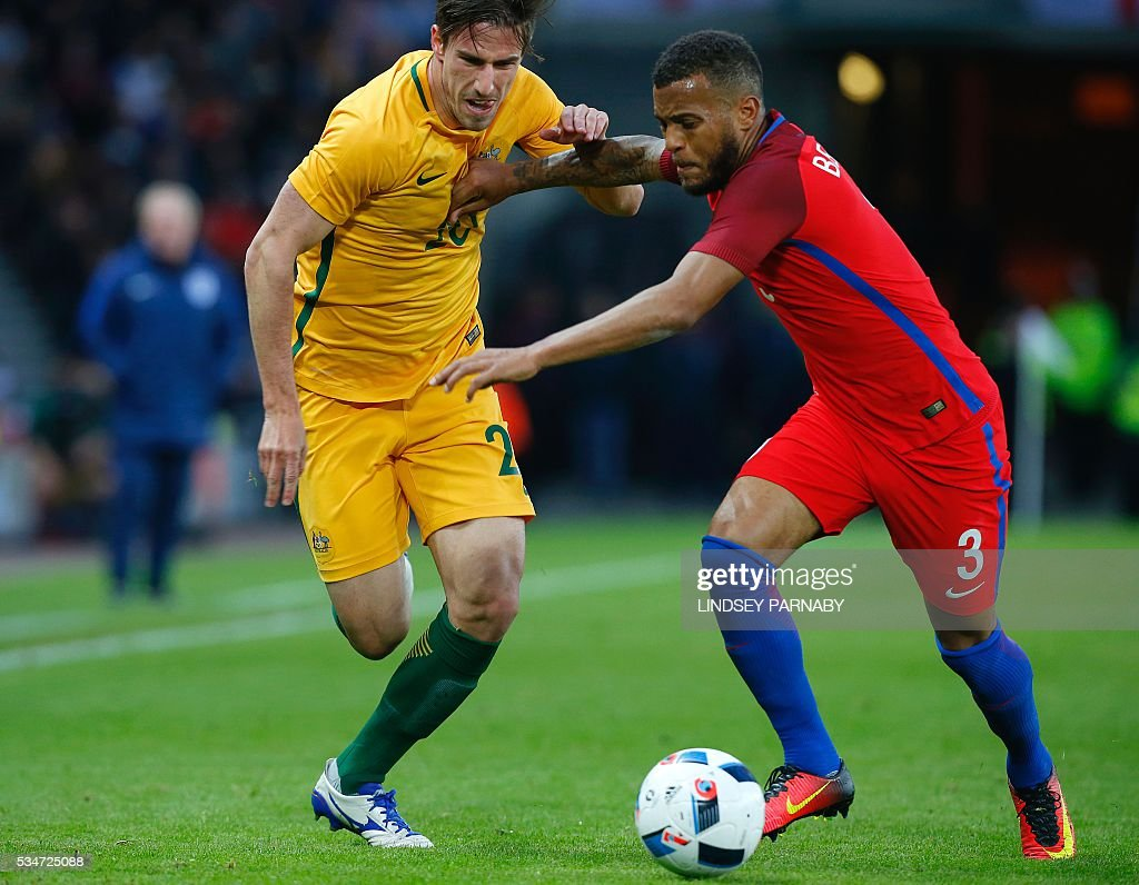 England's defender Ryan Bertrand (R) vies for the ball against Australia's Milos Degenek during the friendly football match between England and Australia at the Stadium of Light in Sunderland, north east England, on May 27, 2016. / AFP / Lindsey PARNABY / NOT
