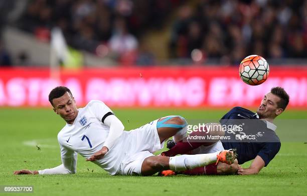 England's Dele Alli and France's Morgan Schneiderlin battle for the ball