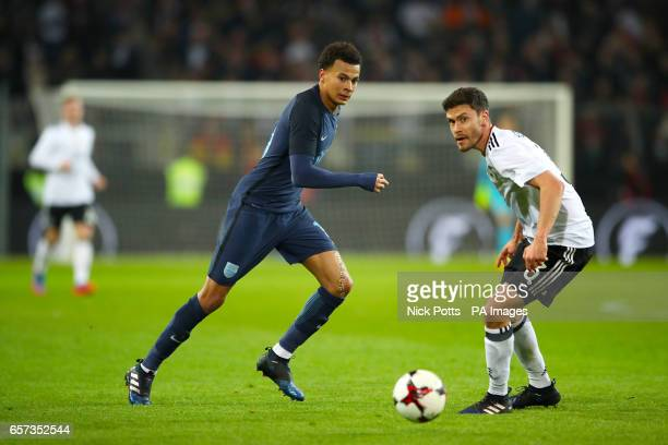 England's Dele Alli and Germany's Jonas Hector battle for the ball