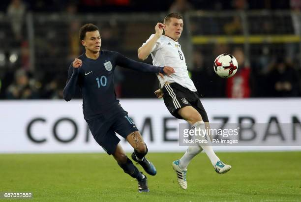England's Dele Alli and Germany's Toni Kroos battle for the ball