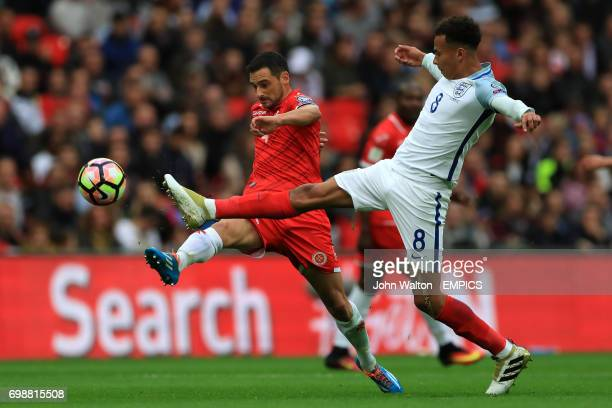 England's Dele Alli and Malta's Gareth Sciberras battle for the ball