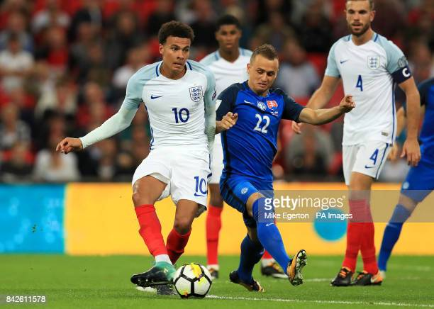 England's Dele Alli and Slovakia's Stanislav Lobotka battle for the ball during the 2018 FIFA World Cup Qualifying Group F match at Wembley Stadium...