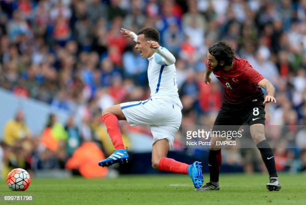 England's Dele Alli and Turkey's Selcuk Inan battle for the ball