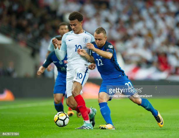 England's Dele Alli holds off the challenge from Slovakia's Stanislav Lobotka during the FIFA 2018 World Cup Qualifier between England and Slovakia...