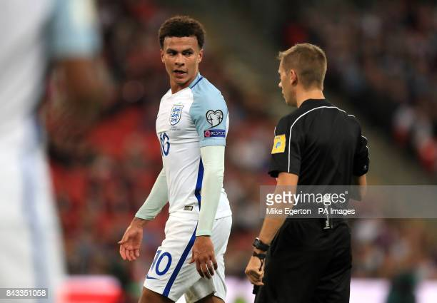 England's Dele Alli speaks with referee Clement Turpin