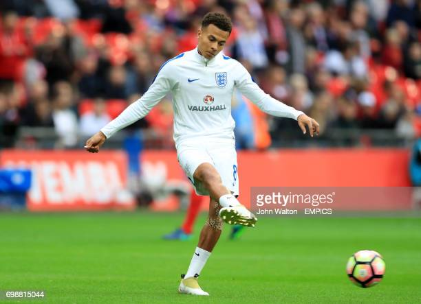 England's Dele Alli warms up before kick off