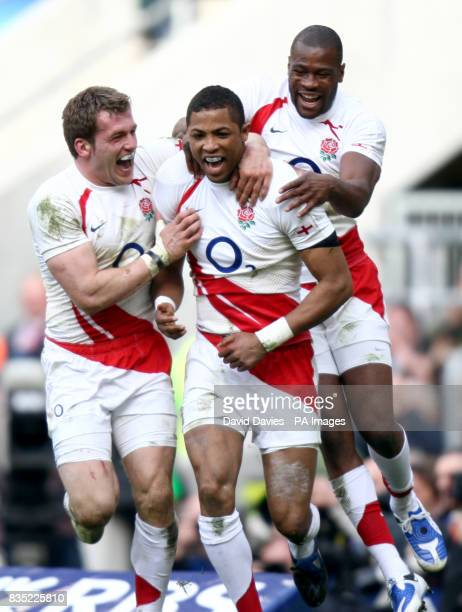 England's Delon Armitage celebrates with his team mates after scoring