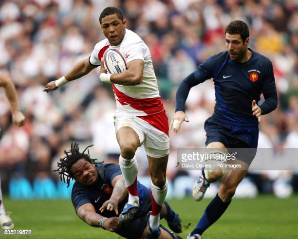 England's Delon Armitage gets away from France's Mathieu Bastareaud during the RBS 6 Nations match at Twickenham London