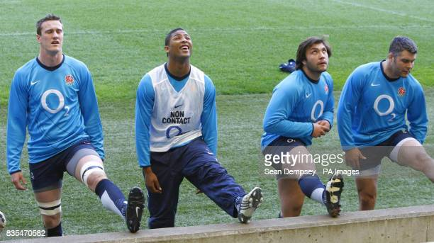 England's Delon Armitage goes through some stretches with teammates during the training session at Twickenham Stadium London