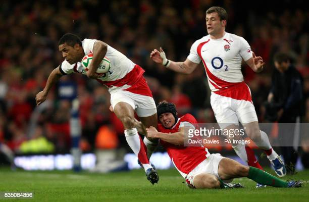 England's Delon Armitage is tackled by Wales Leigh Halfpenny during the RBS 6 Nations match at the Millennium Stadium Cardiff