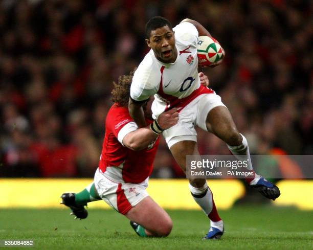 England's Delon Armitage tackled by Adam Jones during the RBS 6 Nations match at the Millennium Stadium Cardiff