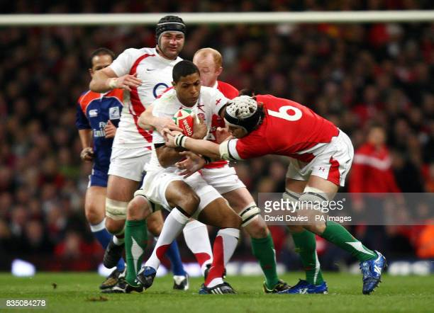 England's Delon Armitage tackled by Wales' Ryan Jones during the RBS 6 Nations match at the Millennium Stadium Cardiff