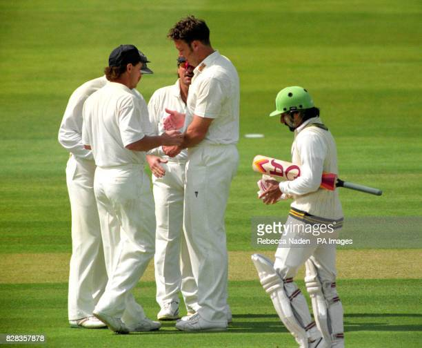 England's Derek Pringle being congratulated by team mates after he caught and bowled Pakistan's Ramiz Raja during the Texaco Trophy match at Lord's