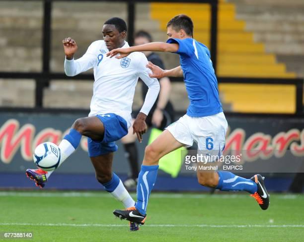 England's Devante Cole and Italy's Alessio Romagnoli in action