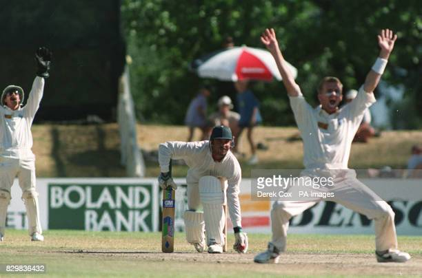 England's Dominic Cork and Jack Russell appeal enthusiasticaly for the lbw wicket of Boland Bank XI LouisMarc Germishuys during today's oneday match...